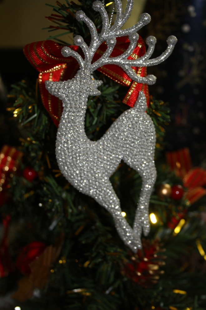 This Reindeer glammed up ornament is also from Debenhams. Surprise Surprise! Their 3 for 2 offer really got to me... You should check it out as well!